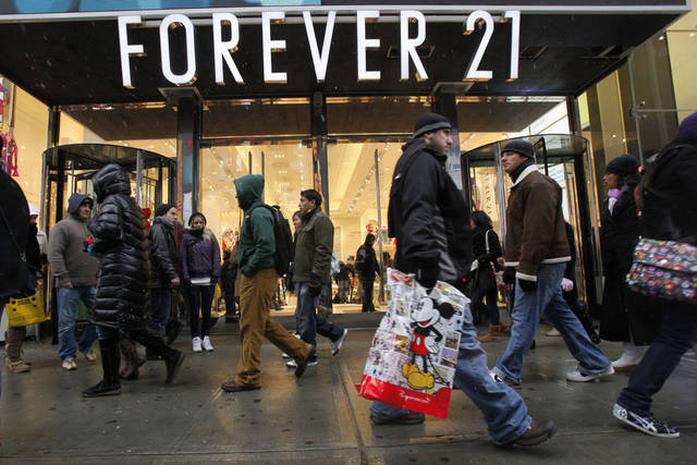 In this file photo, people walk past a Forever 21 store in New York's Times Square. A Forever 21 store is coming to Penn Square Mall in Oklahoma City.  (AP Photo/Mary Altaffer, file) ORG XMIT: NYBZ132 <strong>Mary Altaffer - AP</strong>