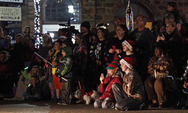 A crowd watches during the Edmond Electric Parade of Lights in downtown Edmond, Okla., Saturday, Dec. 8, 2012. Photo by Bryan Terry, The Oklahoman