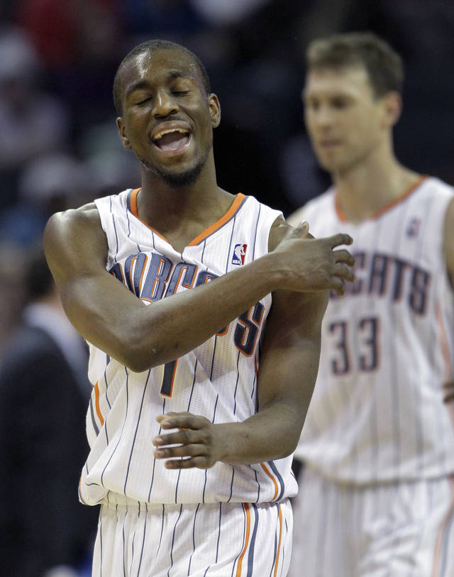 Charlotte Bobcats' Kemba Walker (1) reacts after missing a shot during the second half of their 102-99 loss to the Washington Wizards in an NBA basketball game in Charlotte, N.C., Saturday, Jan. 28, 2012. (AP Photo/Chuck Burton)