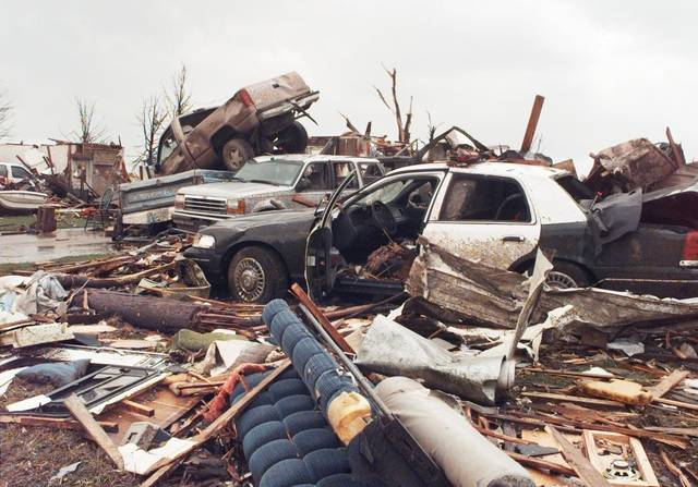 MAY 3, 1999 TORNADO: Tornado damage: Area of NW 27TH AND I-35 IN MOORE OKLA.  Moore police car and other vehicles in the 2500 block of Ridgewood  (Nolans Clay's housing addition Highland Park) Just south of the First Baptist Church.