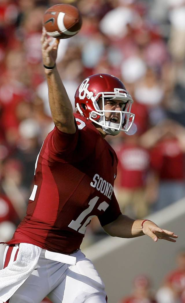OU's Landry Jones throws a pass during the second half of the college football game between the University of Oklahoma Sooners (OU) and Florida State University Seminoles (FSU) at the Gaylord Family-Oklahoma Memorial Stadium on Saturday, Sept. 11, 2010, in Norman, Okla.   Photo by Bryan Terry, The Oklahoman