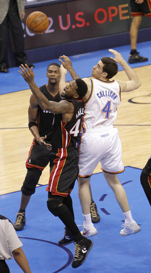 Oklahoma City's Nick Collison (4) defends on Miami's Udonis Haslem (40) during Game 2 of the NBA Finals between the Oklahoma City Thunder and the Miami Heat at Chesapeake Energy Arena in Oklahoma City, Thursday, June 14, 2012. Photo by Chris Landsberger, The Oklahoman