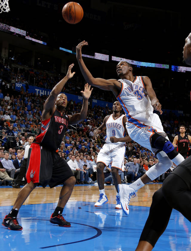 Oklahoma City's Kevin Durant (35) puts up a shot over Toronto's Kyle Lowry (3) during an NBA basketball game between the Oklahoma City Thunder and the Toronto Raptors at Chesapeake Energy Arena in Oklahoma City, Tuesday, Nov. 6, 2012.  Tuesday, Nov. 6, 2012. Oklahoma City won 108-88. Photo by Bryan Terry, The Oklahoman