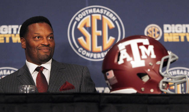 Texas A&M coach Kevin Sumlin smiles as he speaks to the media at the Southeastern Conference NCAA college football media day in Hoover, Ala. on Tuesday, July 17, 2012. (AP Photo/Butch Dill)