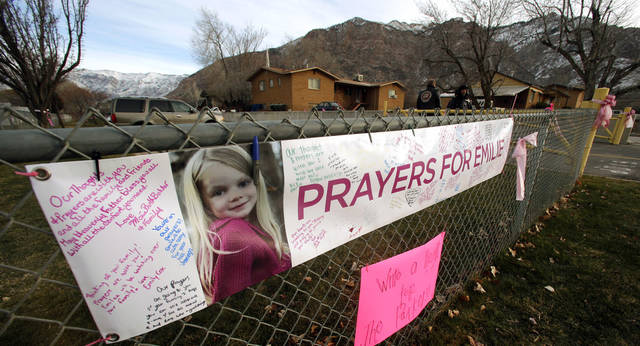"A ""prayers for Emilie"" sign hangs on a fence along a street in Ogden, Utah, Saturday, Dec. 22, 2012. Funeral services were held Saturday for Connecticut elementary shooting victim Emilie Parker, one of 20 children and six adult victims killed in a Dec. 14 mass shooting at Sandy Hook Elementary in Newtown, Conn.  (AP Photo/Rick Bowmer) ORG XMIT: UTRB111"