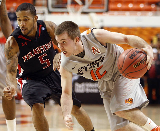OSU's Keiton Page (12) dribbles past Texas Tech defender Javarez Willis (5) in the first half of a men's college basketball game between the Oklahoma State University Cowboys and the Texas Tech University Red Raiders at Gallagher-Iba Arena in Stillwater, Okla., Wednesday, Jan. 4, 2012. Photo by Nate Billings, The Oklahoman
