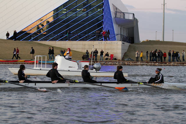 Members of the Putnam City High School crew row past the Devon Boathouse during last year�s OKC Riversport Youth League Championship on the Oklahoma River. OKLAHOMAN archive photo