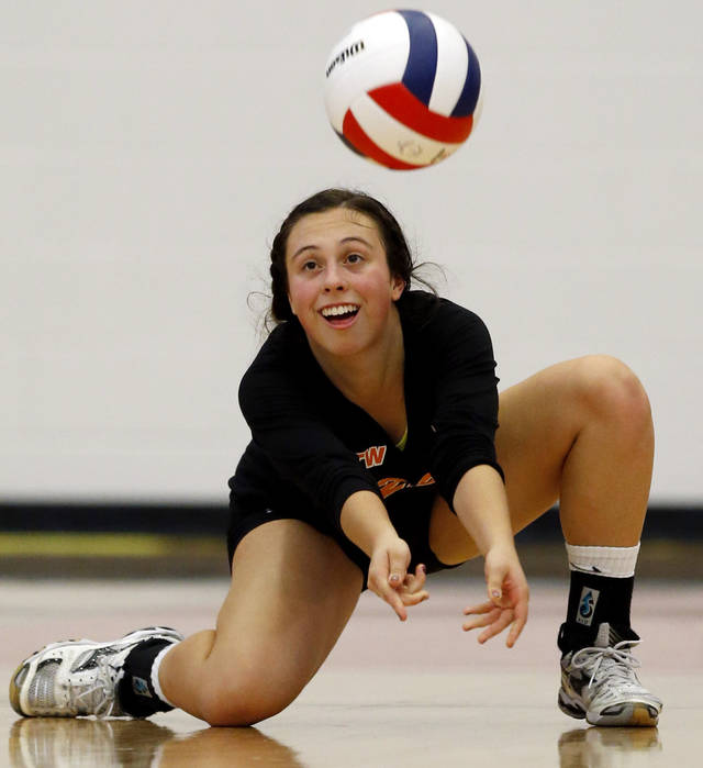 Booker T. Washington's Jane Eagleton returns a ball against Shawnee during the Class 5A State Championship volleyball tournament on Friday, Oct. 12, 2012, in Moore, Okla.  Photo by Steve Sisney, The Oklahoman