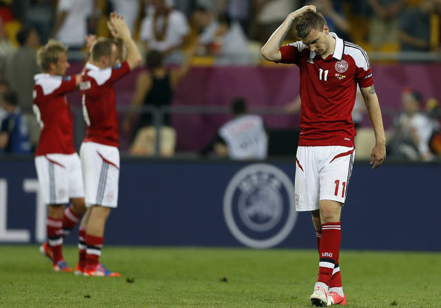 Denmark's Nicklas Bendtner, right, walks off the pitch at the end of the Euro 2012 soccer championship Group B match between Denmark and Germany in Lviv, Ukraine, Sunday, June 17, 2012. Denmark lost 1-2. (AP Photo/Frank Augstein)