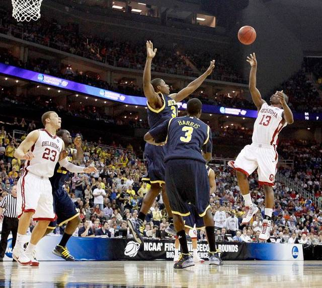 OU's Willie Warren shoots the ball over Michigan's DeShawn Sims, left, and Manny Harris during a second-round men's NCAA college basketball tournament game between Oklahoma and Michigan in Kansas City, Mo., Saturday, March 21, 2009. Oklahoma won 73-63. PHOTO BY BRYAN TERRY, THE OKLAHOMAN