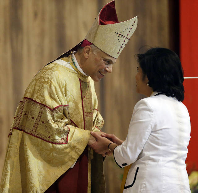 Salvatore J. Cordileone greets a congregation member during a ceremony to install him as the new archbishop of San Francisco at the Cathedral of St. Mary of the Assumption in San Francisco, Thursday, Oct. 4, 2012. (AP Photo/Marcio Jose Sanchez, Pool)