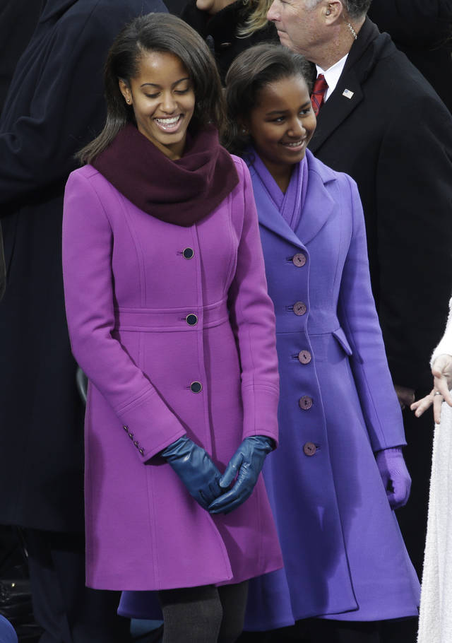 Sasha and Malia Obama arrive at the ceremonial swearing-in of their father President Barack Obama at the U.S. Capitol during the 57th Presidential Inauguration in Washington, Monday, Jan. 21, 2013. (AP Photo/Paul Sancya)