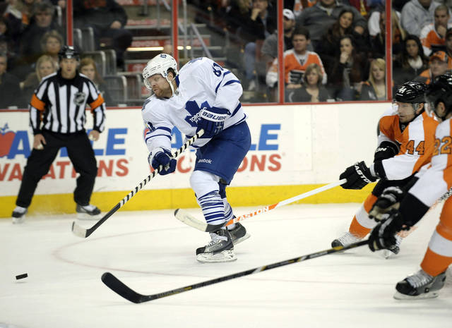 Toronto Maple Leafs' Phil Kessel (81) shoots and scores a goal in front of Philadelphia Flyers' Kimmo Timonen (44), of Finland, in the first period of an NHL hockey game, Monday, Feb 25, 2013, in Philadelphia. (AP Photo/Michael Perez)