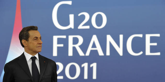 French President Nicolas Sarkozy waits for arrivals at the G20 summit in Cannes, France on Thursday, Nov. 3, 2011. French President Nicolas Sarkozy will welcome Barack Obama of the U.S., Hu Jintao of China as well as the leaders of India, Brazil, Russia and the other members of the Group of 20 leading world economies in the city made famous by its annual film festival, but the event is far from the star turn the unpopular French leader had hoped to make six months before he faces a tough re-election vote. (AP Photo/Philippe Wojazer, Pool)