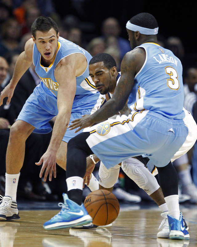 Memphis Grizzlies guard Mike Conley is trapped between Denver Nuggets forward Danilo Gallinari, left, of Italy, and guard Ty Lawson (3) in the first half of an NBA basketball game on Saturday, Dec. 29, 2012, in Memphis, Tenn. (AP Photo/Lance Murphey)