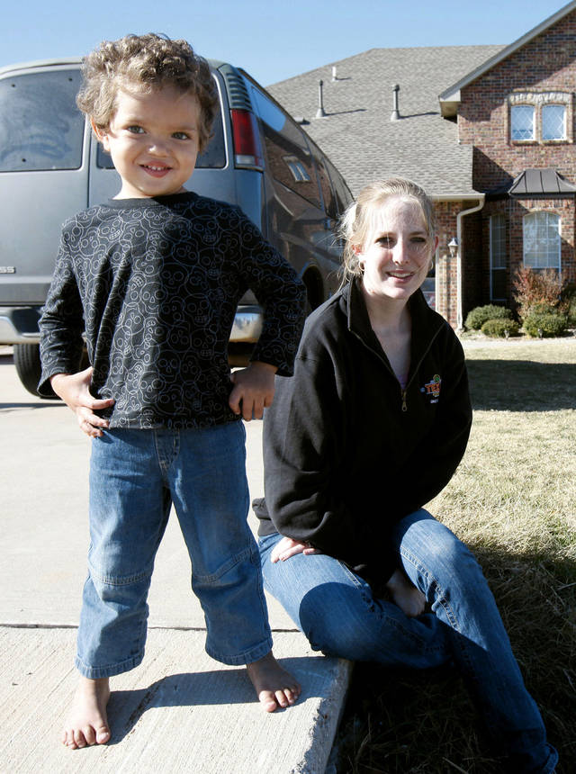Ashley Warden was ticketed by police after her 3-year-old son son Dillan tried to urinate in their front yard in Piedmont, OK, Tuesday, November 6, 2012,  By Paul Hellstern. Piedmont police chief says writing the ticket was a mistake. The Oklahoman
