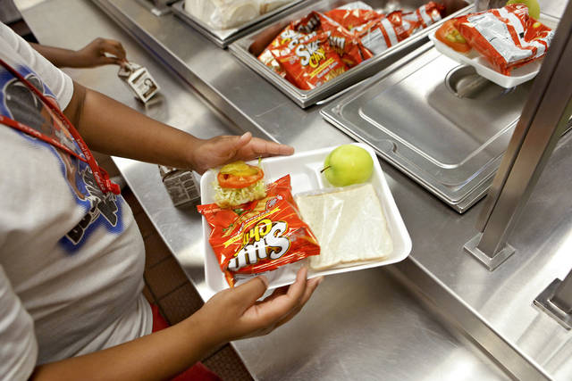 Lunches are handed out  as part of the Oklahoma City Schools' summer lunch program last summer at Martin Luther King Elementary School. PHOTO BY CHRIS LANDSBERGER, THE OKLAHOMAN ARCHIVE