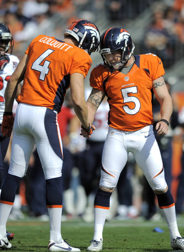 FILE - In this Sept. 23, 2012, file photo, Denver Broncos kicker Matt Prater (5) celebrates a field goal with teammate Britton Colquitt (4) against the Houston Texans during an NFL football game in Denver. Colquitt punted an astonishing 101 times last season. This year, it's down to 37 punts, on pace for 66. Yet, he still is getting plenty of work - as Prater's holder. (AP Photo/Jack Dempsey, File)
