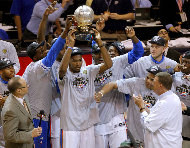 Oklahoma City's Kevin Durant holds the Western Conference trophy beside Nazr Mohammed, left, Kendrick Perkins, Serge Ibaka, Royal Ivey, Russell Westbrook, Cole Aldrich and Reggie Jackson after Game 6 of the Western Conference Finals between the Oklahoma City Thunder and the San Antonio Spurs in the NBA playoffs at the Chesapeake Energy Arena in Oklahoma City, Wednesday, June 6, 2012. Oklahoma City won 107-99. Photo by Bryan Terry, The Oklahoman