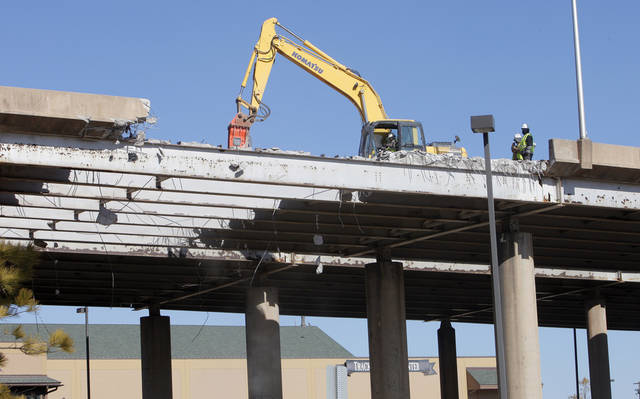Workers have started removing the deck and side walls of the eastbound lanes of the former I-40 Tuesday, Jan. 17, 2012. Photo by Paul B. Southerland, The Oklahoman