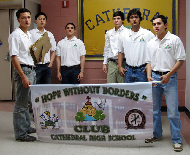 In this Nov. 15, 2011 photo, from left, Cathedral High School students Carlos Gomez,17, Andy Leos, 16, Daniel Garibay, 17, Nick Venecia,16, Alex Zamora, 15, and Guillermo Lopez, 16, pose for a picture in El Paso, Texas. Following the killing of two of their schoolmates in 2001 in Ciudad Juarez, these students formed the Hope Without Borders group to help raise awareness on violence and victimization in the El Paso-Ciudad Juarez area. (AP Photo/Juan Carlos Llorca)