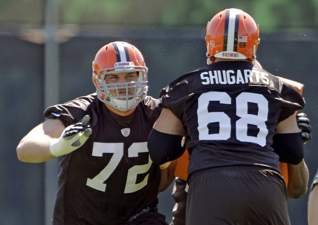 Cleveland Browns offensive lineman Michael Schwartz (72) blocks Jeff Shugarts (68) during practice at the NFL football team's rookie camp in Berea, Ohio Friday, May 11, 2012. (AP Photo/Mark Duncan)