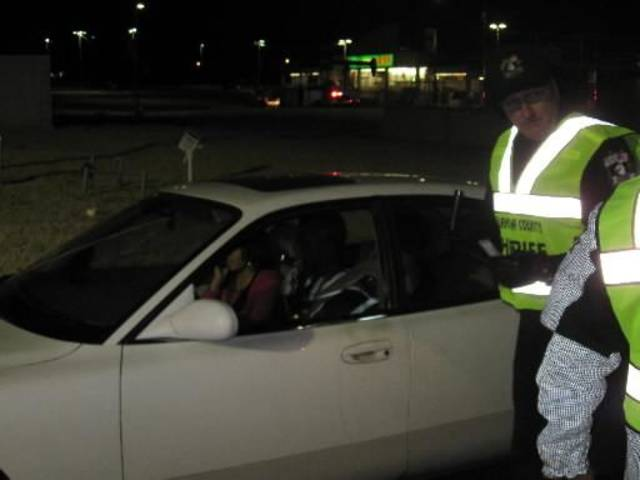 Oklahoma County sheriff's deputies hold a traffic checkpoint at the intersection of W Hefner Road and N Pennsylvania Avenue Jan. 25. Photo by Matt Dinger