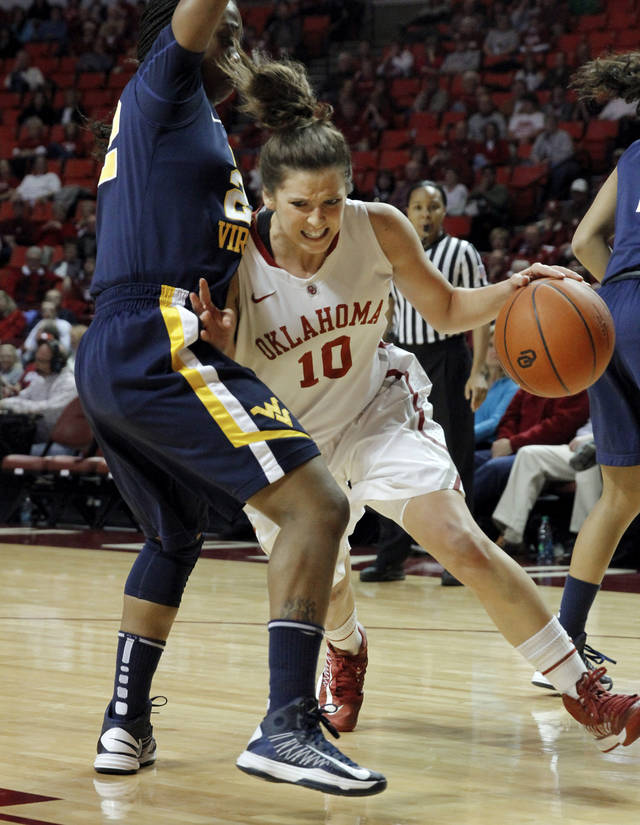 Oklahoma Sooner&#039;s Morgan Hook (10) dribbles past West Virginia Mountaineers&#039; Darius Faulk (12) as the University of Oklahoma Sooners (OU) play the West Virginia Mountaineers in NCAA, women&#039;s college basketball at The Lloyd Noble Center on Wednesday, Jan. 2, 2013  in Norman, Okla. Photo by Steve Sisney, The Oklahoman