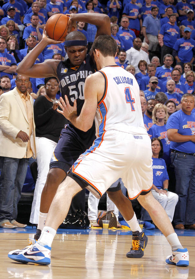 Oklahoma City's Nick Collison (4) defends against Zach Randolph (50) of Memphis during game 7 of the NBA basketball Western Conference semifinals between the Memphis Grizzlies and the Oklahoma City Thunder at the OKC Arena in Oklahoma City, Sunday, May 15, 2011. Photo by Sarah Phipps, The Oklahoman