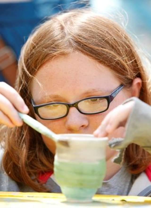 11 year-old Alexis Trayah paints her clay pottery at the Festival of the Arts in Oklahoma City, Oklahoma , April 29 , 2011. Photo by Steve Gooch,
