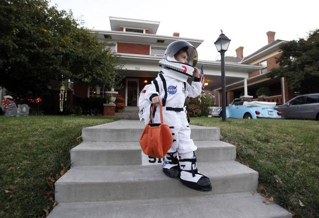 Alex Spiropoulos, 4, trick or treats, Saturday Oct. 30, 2010, in the Mesta Park  Neighborhood in Oklahoma City. Photo by Sarah Phipps, The Oklahoman