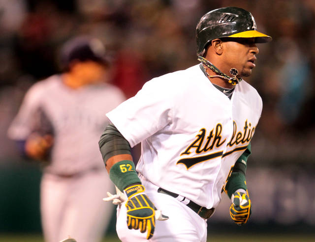 Oakland Athletics' Yoenis Cespedes runs the bases after connecting for a two-run home run off of Seattle Mariners starting pitcher Jason Vargas in the fourth inning of a baseball game in Oakland, Calif., on Friday, April 6, 2012. (AP Photo/The Tribune, Ray Chavez) MAGS OUT; MANDATORY CREDIT