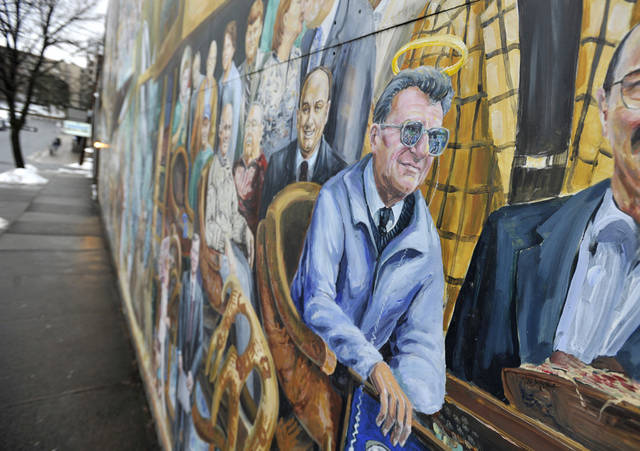 This Monday, Jan. 23, 2012 photo shows a mural by Michael Pilato in State College, Pa. depicting a halo over the late Penn State football coach Joe Paterno. On Saturday, July 14, 2012, the artist removed the halo from the painting amid the school's child sex-abuse scandal. (AP Photo/Centre Daily Times, Nabil K. Mark)