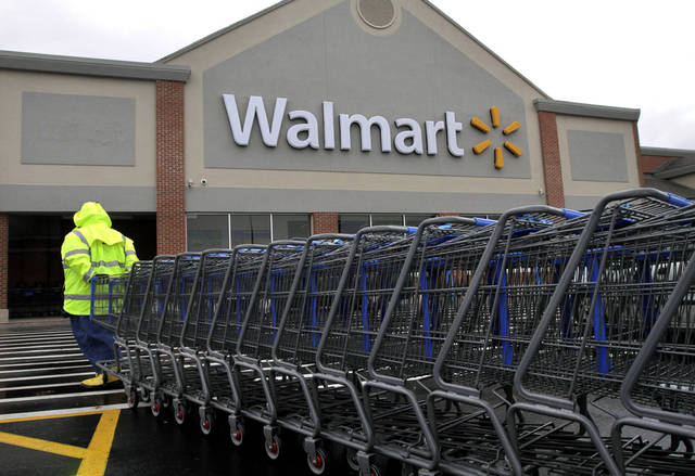 A worker pulls a line of shopping carts toward a Walmart store in North Kingstown, R.I. AP Photo <strong>Steven Senne</strong>