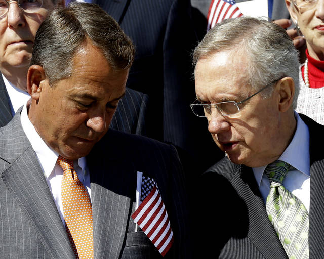 House Speaker John Boehner of Ohio, left, talks with Senate Majority Leader Harry Reid of Nev., on Capitol Hill in Washington, Tuesday, Sept. 11, 2012, during a Congressional remembrance ceremony for the events of 9/11. (AP Photo/Alex Brandon)