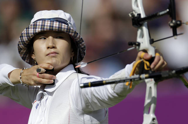 South Korea's Ki Bo-bae shoots during the individual archery competition at the 2012 Summer Olympics, Thursday, Aug. 2, 2012, in London. (AP Photo/Marcio Jose Sanchez)