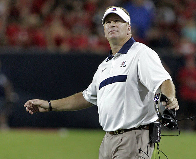 FILE - In this Sept. 3, 2011, file photo, Arizona coach Mike Stoops looks at the stadium video screen during the first half against Northern Arizona in an NCAA college football game at Arizona Stadium in Tucson, Ariz.  (AP Photo/John Miller, File) ORG XMIT: NY162