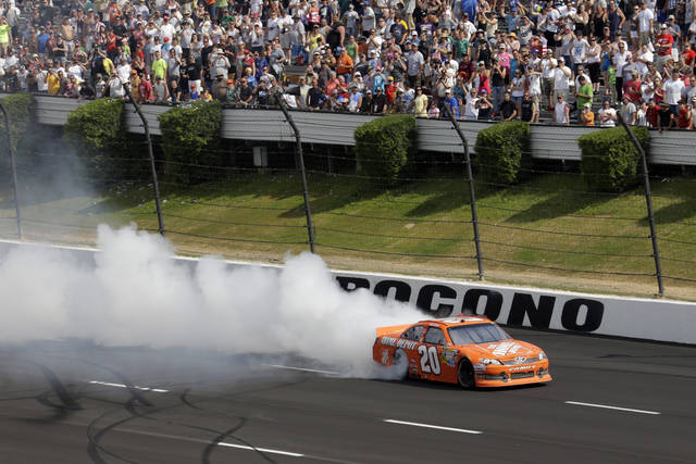 Joey Logano smokes his tires after winning NASCAR's Sprint Cup Series Pocono 400 auto race on Sunday, June 10, 2012, in Long Pond, Pa. (AP Photo/Matt Slocum)