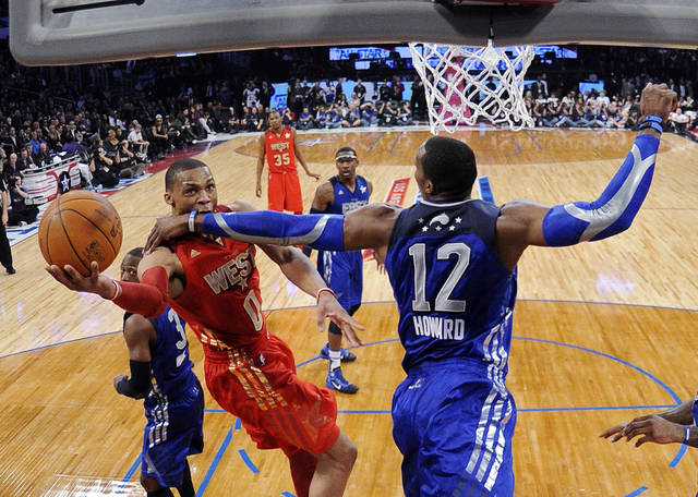 West's Russell Westbrook, left, of the Oklahoma City Thunder, goes up for a shot as East's Dwight Howard, of the Orlando Magic, defends during the first half of the NBA basketball All-Star Game, Sunday, Feb. 20, 2011, in Los Angeles. (AP Photo/Mark J. Terrill)
