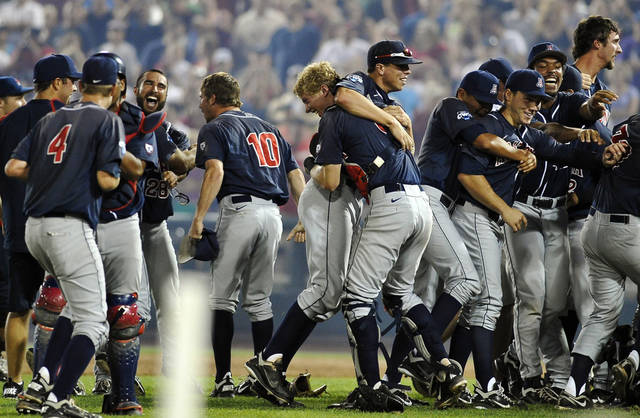 Arizona players celebrate their 4-1 victory over South Carolina in Game 2 to win the NCAA College World Series baseball finals in Omaha, Neb., Monday, June 25, 2012. (AP Photo/Eric Francis)