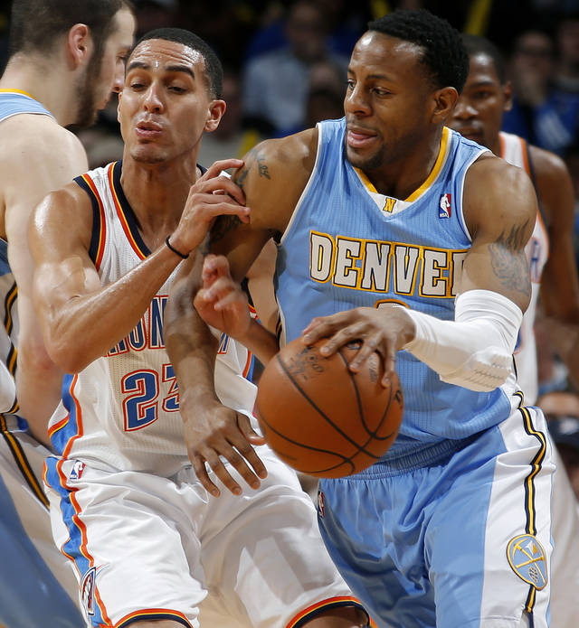 Denver's Andre Iguodala (9) goes past Oklahoma City's Kevin Martin (23) during an NBA basketball game between the Oklahoma City Thunder and the Denver Nuggets at Chesapeake Energy Arena in Oklahoma City, Tuesday, March 19, 2013. Denver won 114-104. Photo by Bryan Terry, The Oklahoman