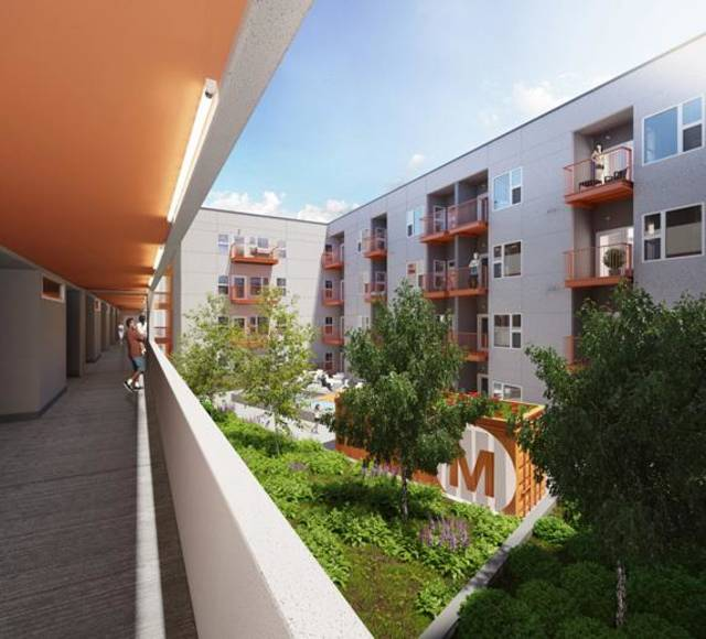 The courtyard of the future Mosaic Apartments, now under construction, is shown in this rendering.