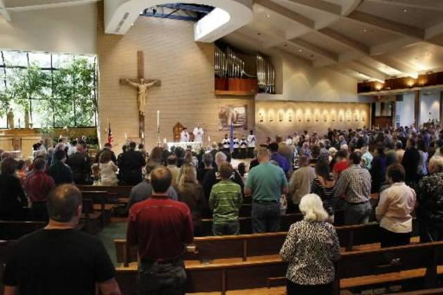 File photo of a Mass at St. John's Catholic Church in Edmond -- Photo by Doug Hoke