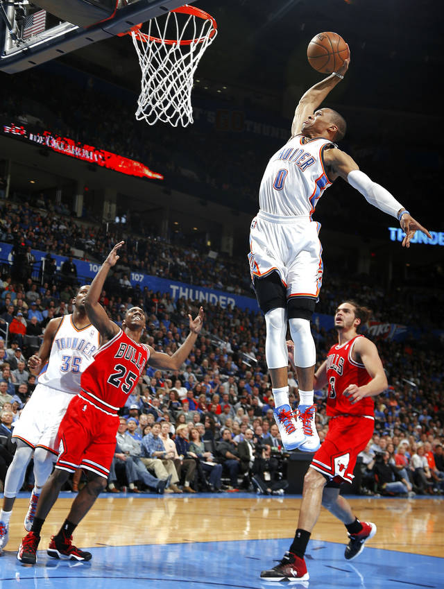 Oklahoma City's Russell Westbrook dunks the ball during the NBA game between the Oklahoma City Thunder and the Chicago Bulls, Sunday, Feb. 24, 2013, at the Chesapeake Energy Arena in Oklahoma City. Photo by Sarah Phipps, The Oklahoman