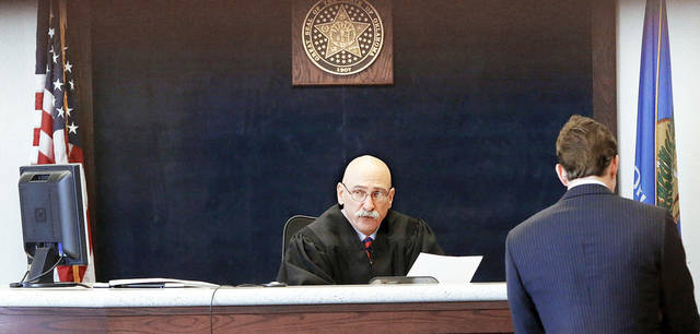 Payne County Special District Judge R.L. Hert Jr. presides over a video arraignment for Oklahoma State University student Nathan Cochran. Cochran, not shown, faces sexual battery charges in connection with reports of sexual assaults.  Photo by Jim Beckel, The Oklahoman