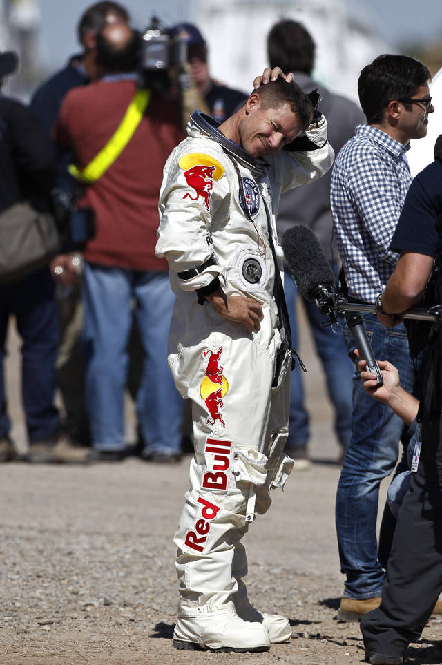 Felix Baumgartner, of Austria, pauses before answering a question during an impromptu interview after successfully jumping from a space capsule lifted by a helium balloon at a height of just over 128,000 feet above the Earth's surface, Sunday, Oct. 14, 2012, in Roswell, N.M.(AP Photo/Ross D. Franklin) ORG XMIT: NMRF122