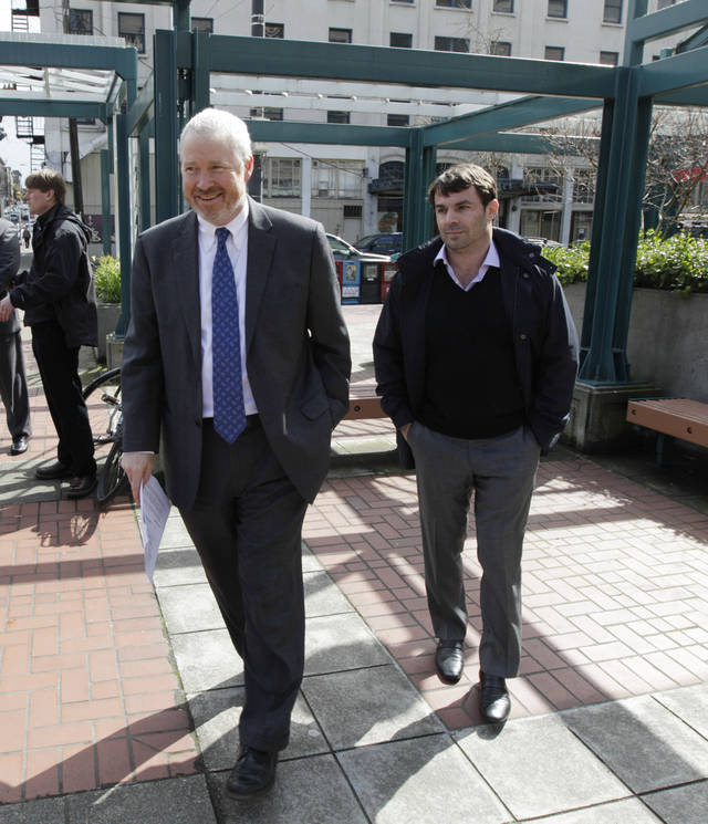 Chris Hansen, right, the venture capitalist who wants to build a new sports arena in Seattle, walks with Seattle Mayor Mike McGinn, left, as they prepare to talk to reporters, Thursday, April 5, 2012, in Seattle. Hansen said he will pay for a study to determine the impacts on traffic and parking around his proposed stadium site south of Seattle and near Safeco Field and CenturyLink Field where the MLB Seattle Mariners and the NFL Seattle Seahawks play. (AP Photo/Ted S. Warren)