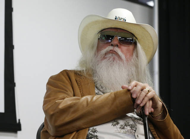 Leon Russell sits with his hands on his cane during a news conference in Tulsa, Okla., Tuesday, Jan. 29, 2013. The Oklahoma Historical Society has acquired a large collection of works by the legendary musician and native Oklahoman that are intended for display in a planned pop culture museum in Tulsa. (AP Photo/Sue Ogrocki)