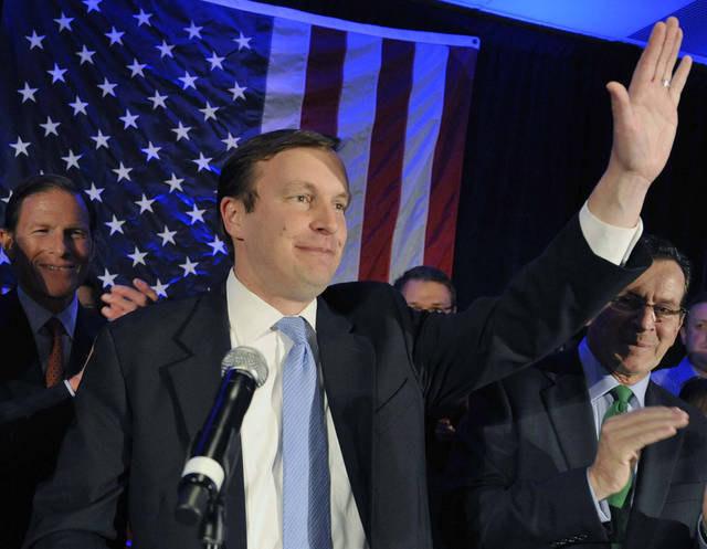 FILE - In this Nov. 6, 2012, file photo, Sen.-elect Chris Murphy, D-Conn., celebrates his win, in Hartford, Conn. (AP Photo/Jessica Hill, File)