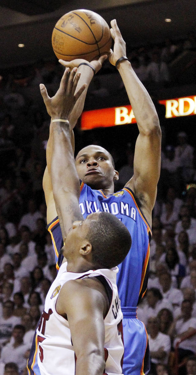 Oklahoma City's Russell Westbrook (0) shoots over Miami's Mario Chalmers (15) during Game 3 of the NBA Finals between the Oklahoma City Thunder and the Miami Heat at American Airlines Arena, Sunday, June 17, 2012. Photo by Bryan Terry, The Oklahoman